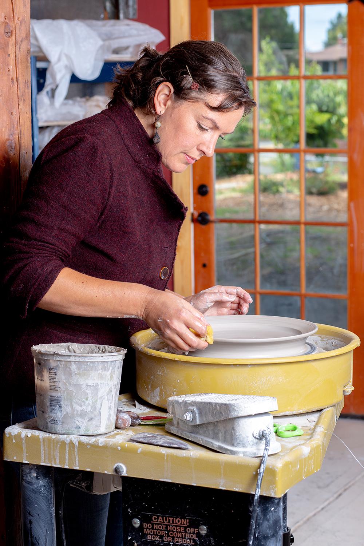 Deborah Schwarzkopf at pottery wheel